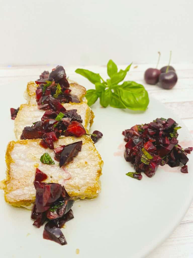 pan-seared pork loin with fresh cherry salsa on top