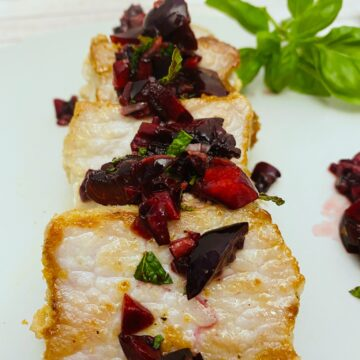 pan fried pork tenderloin pieces topped with a fresh cherry,basil and mint salsa