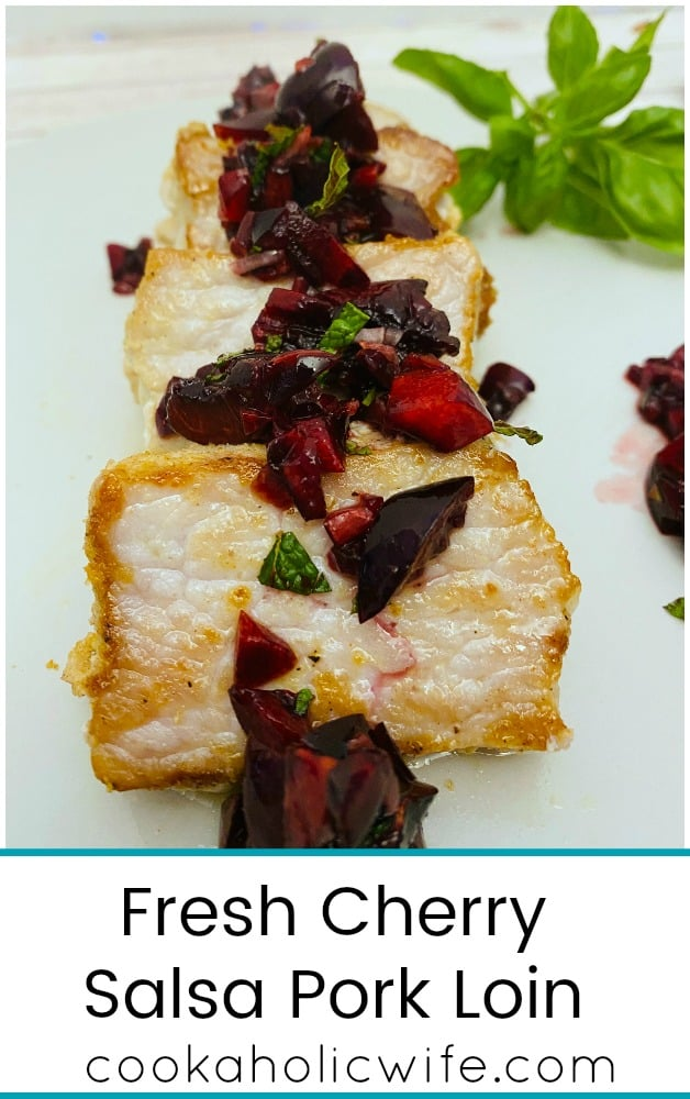 pan-seared pork tenderloin slices topped with a fresh cherry salsa made with mint and basil