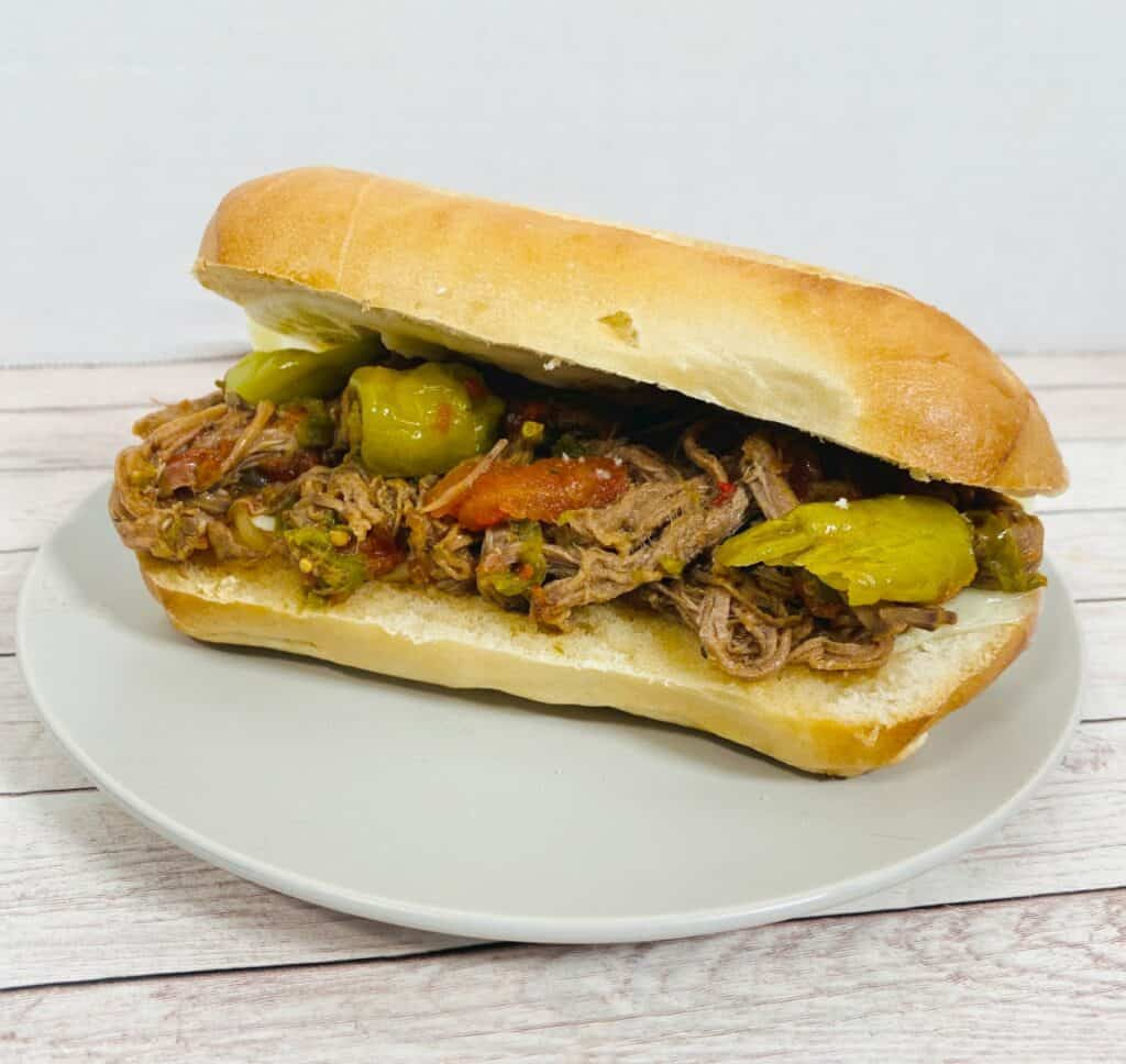 shredded italian beef mixed with pepperoncini and tomatoes on a toasted hoagie roll with provolone cheese