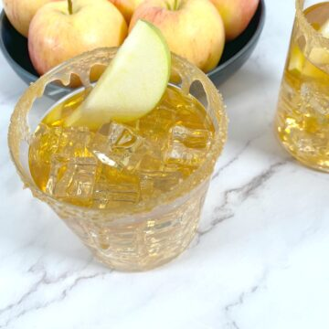 caramel apple whiskey sour cocktail in glass