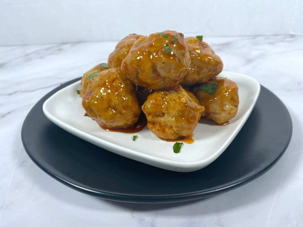 firecracker chicken meatballs on a white plate