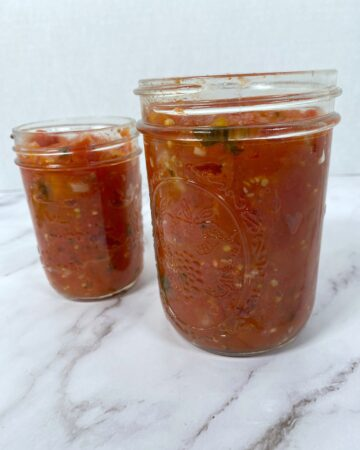homemade canned tomato sauce in mason jar
