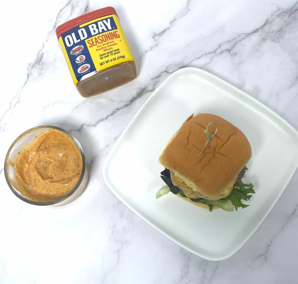 old bay burger, with old bay burger sauce and can of old bay