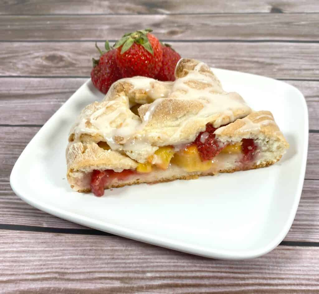 peaches and strawberries baked into a sweet, braided dough