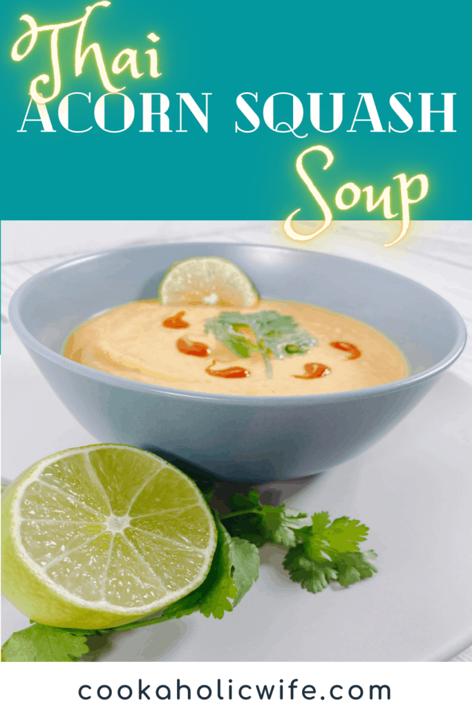 thai acorn squash soup pureed in bowl, garnished with cilantro leaves and sriracha