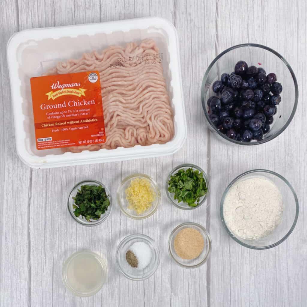 ingredients for blueberry chicken meatballs - ground chicken, blueberries, fresh basil, fresh mint, flour, seasonings