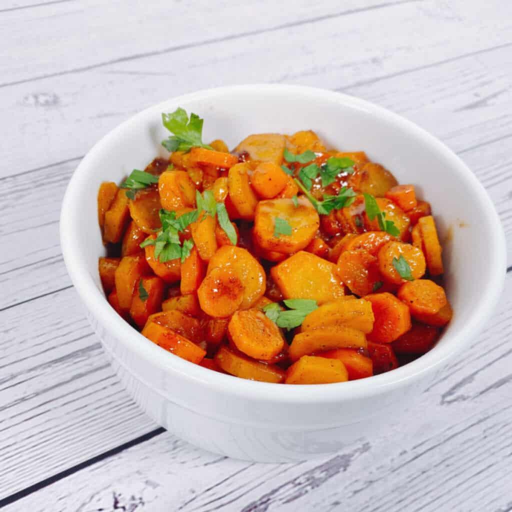 cardamom brown sugar carrots in a white bowl