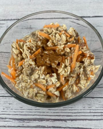 carrot cake overnight oats in a glass bowl