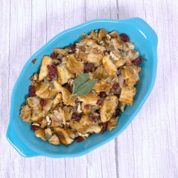 Cranberry pecan stuffing in a teal dish