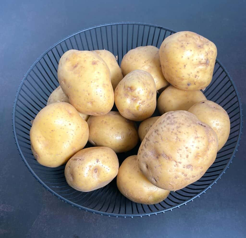 a blue bowl of yukon gold potatoes