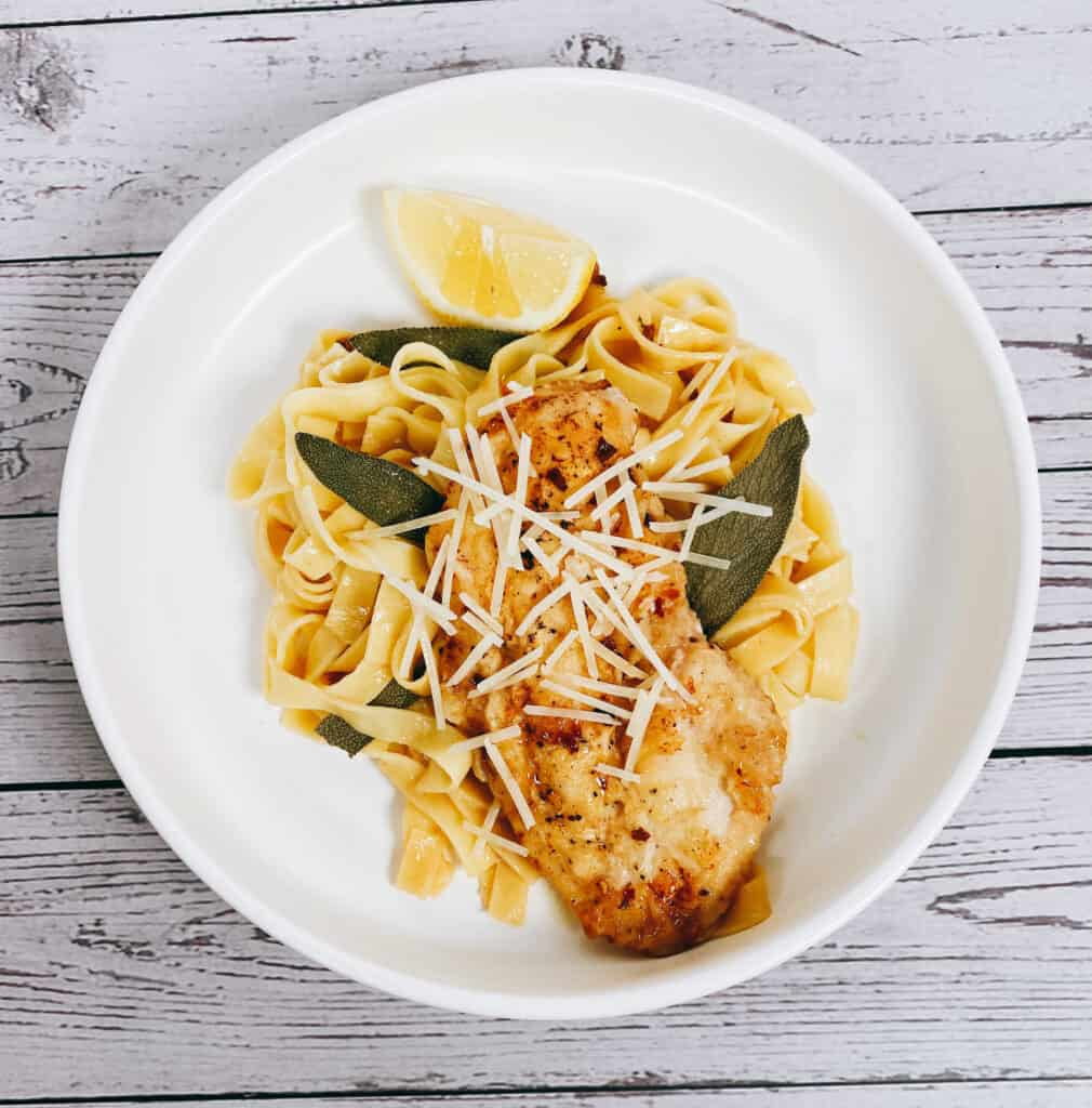 sage butter chicken pasta in a white bowl
