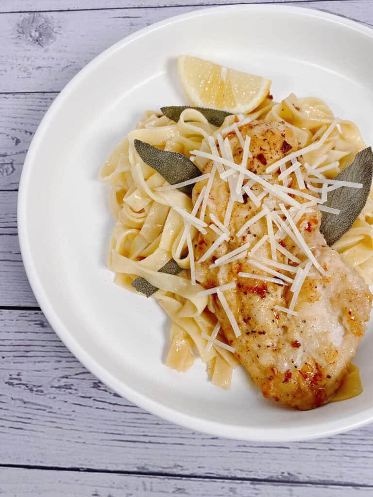 sage butter chicken pasta in a white bowl