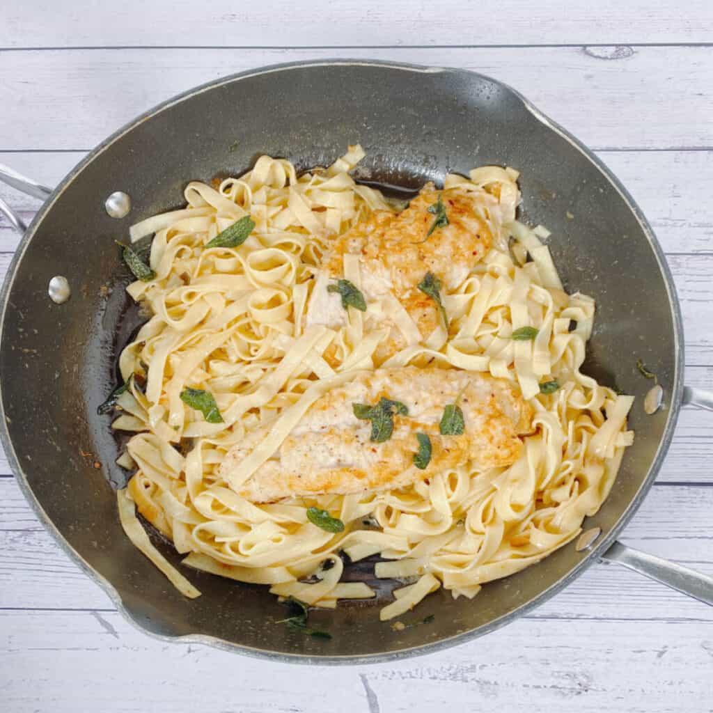 sage butter chicken pasta in a skillet