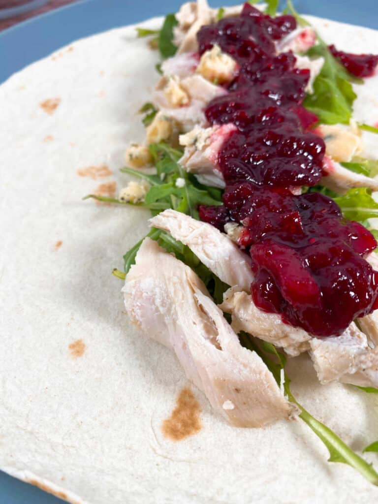 Thanksgiving Turkey Cranberry Wrap – leftover turkey and cranberry sauce are added to a wrap along with blue cheese and arugula