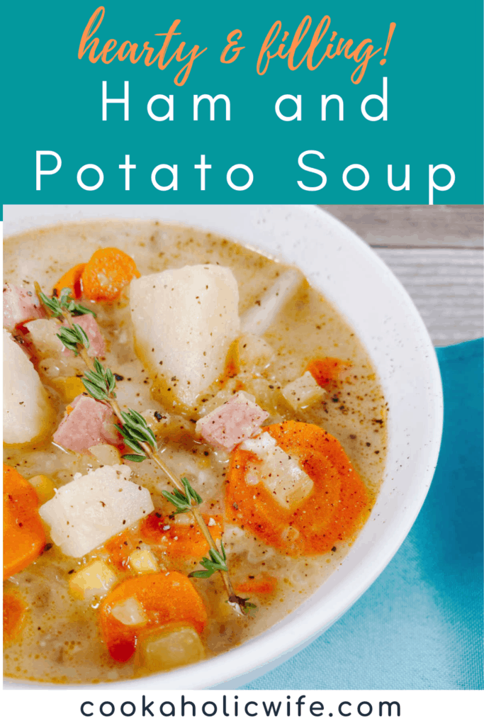 A white bowl of creamy ham and potato soup covers nearly all of the image. In the bottom corner is a turquoise napkin. The bowl of soup is full of pieces of potato, ham, carrot and corn. Salt and pepper season the dish, with a sprig of fresh thyme on top.