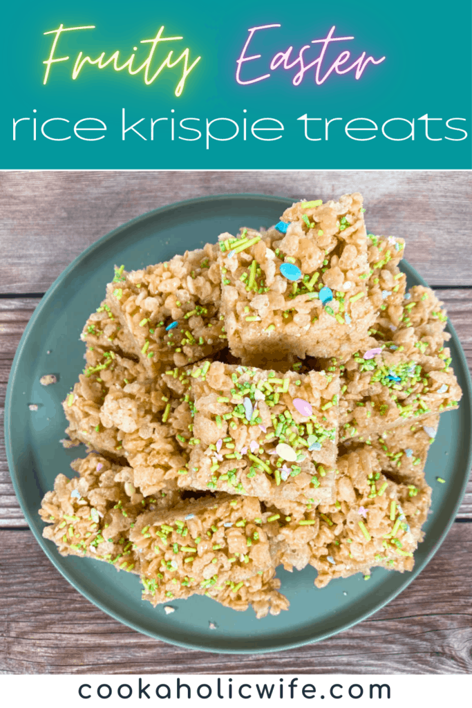 a pile of fruity easter rice krispies sits on a pale green plate on a wooden background. the treats are covered with Easter sprinkles, pastel in color and some are in the shape of easter eggs.