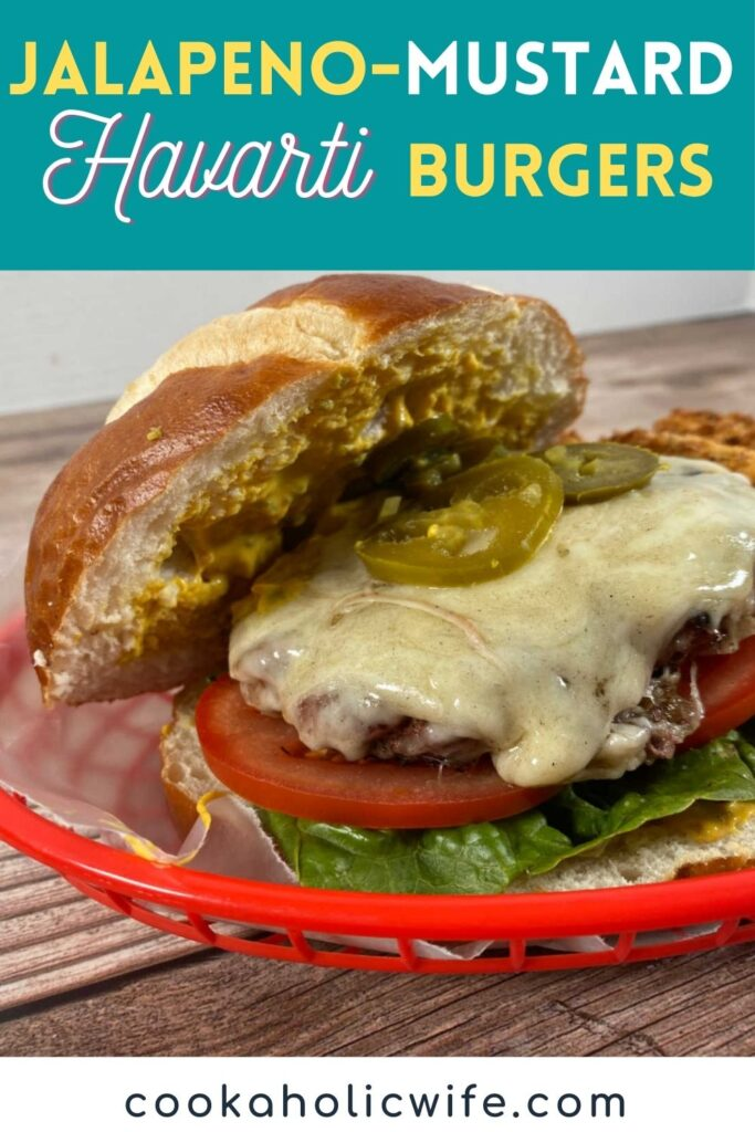 Image for Pinterest. Overlay text states recipe name and website at bottom. Image is side shot of the burger in a red bakset.