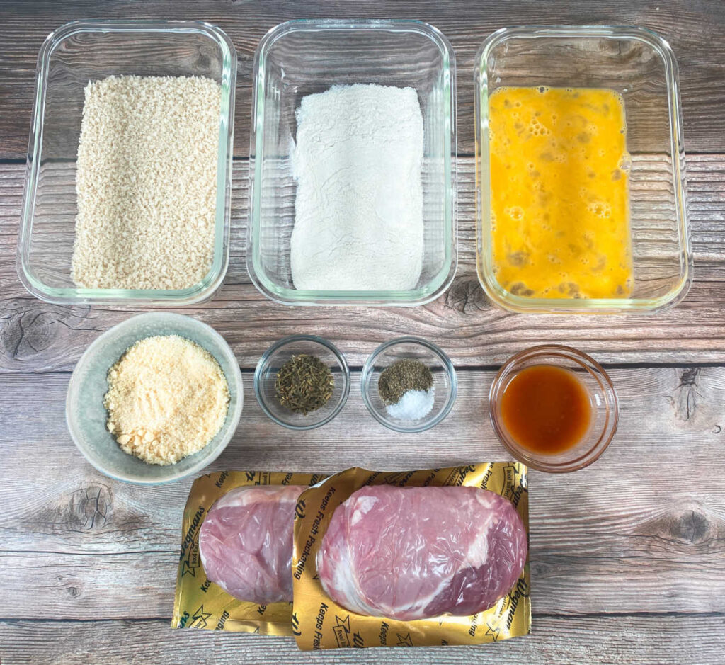 ingredients for this recipe sit in bowls on a wooden background.
