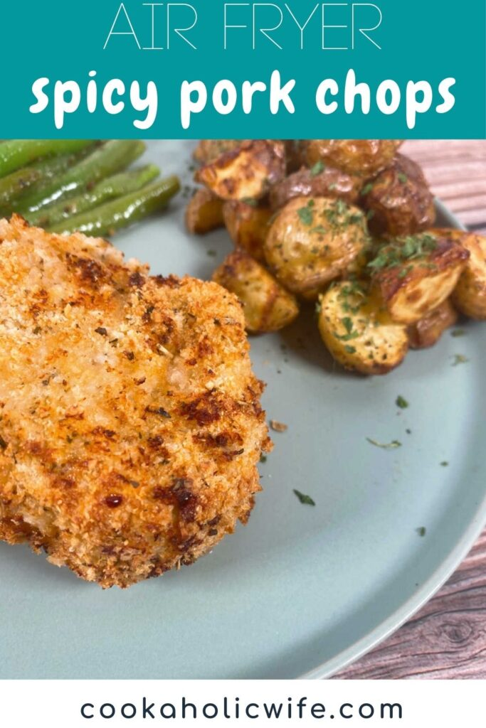 Image for Pinterest with recipe title text overlay at top. Crusted pork chop sits on a green plate with roasted potatoes and green beans.