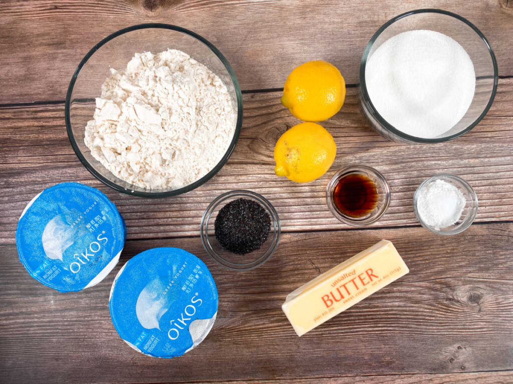 ingredients for the muffins sit on a wooden background