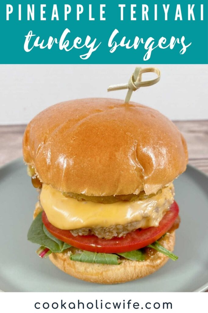 Image for Pinterest - top of image has text overlay with recipe title. Prepared burger sits on a light green plate