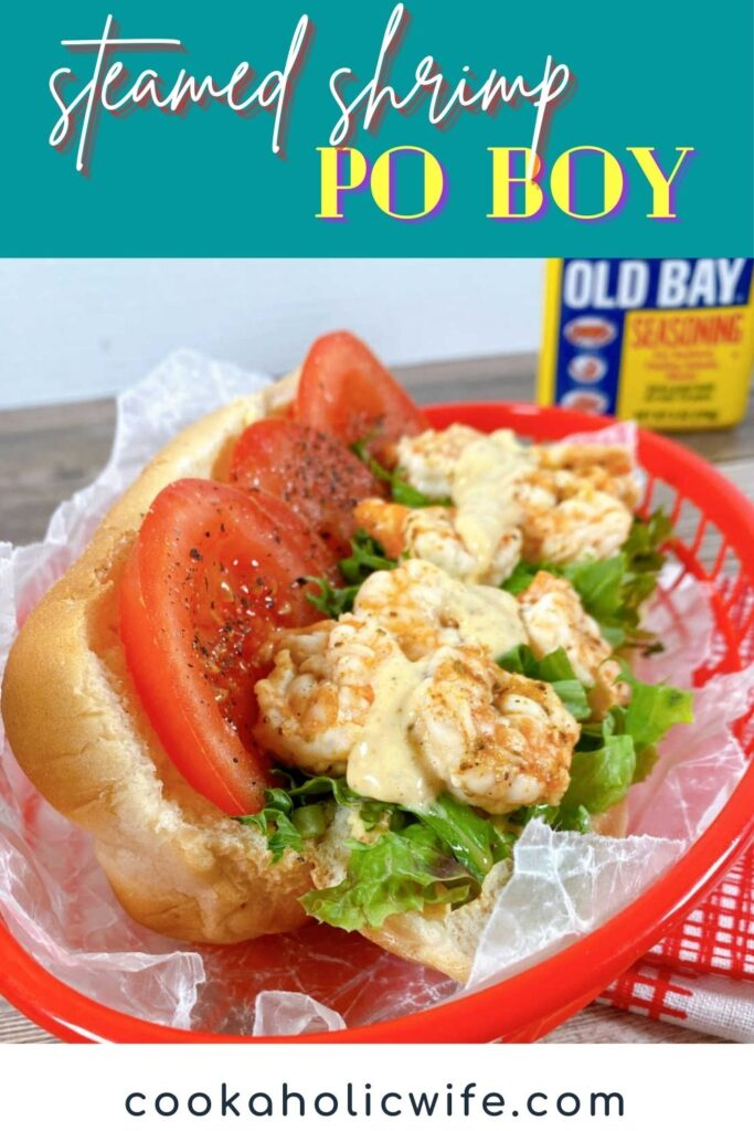 Image for Pinterest with text overlay at top and bottom. Top is the name of the recipe, bottom is the website. Image: Close up of the sandwich, showing the shrimp, sauce, tomato slices and lettuce.