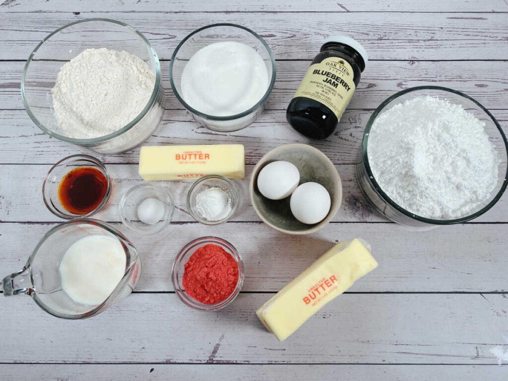 ingredients to make this recipe sit in bowls on a white wooden background,.