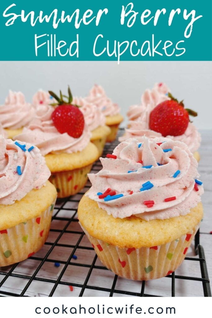image for Pinterest with text overlay of recipe title at top. Decorated cupcakes sit on a wire cooling rack.