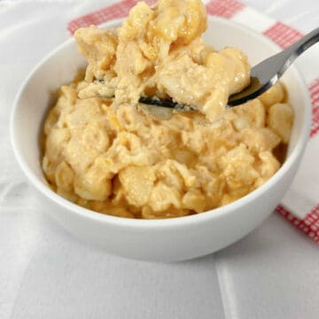 large white bowl full of macaroni and cheese