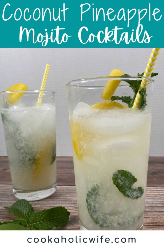two tall glasses of coconut pineapple mojitos sit on a wooden background. Glasses are garnished with pineapple and fresh mint.