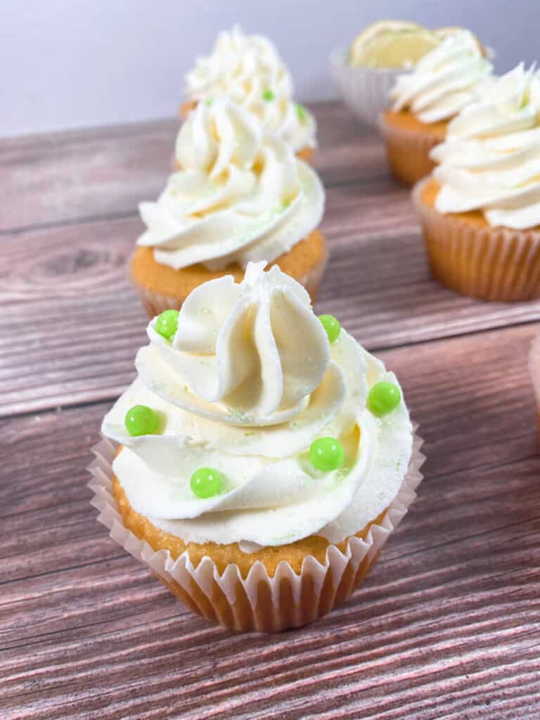 close up of the cupcake decorate with large green sprinkle balls.