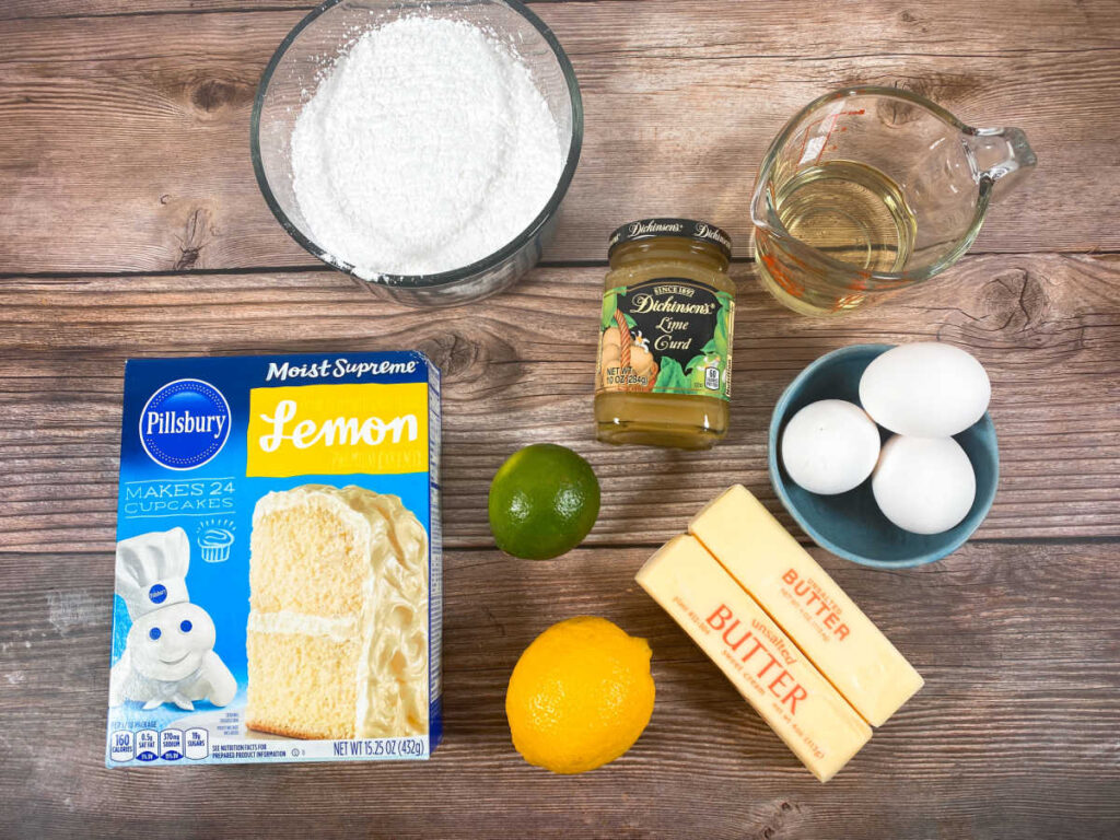 ingredients to make the cupcakes sit on a wooden background
