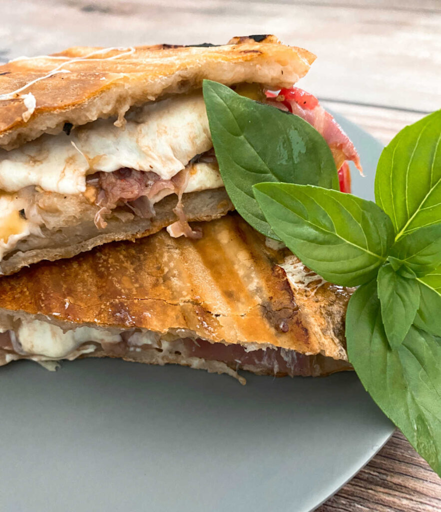 close up image of the panini sliced in half.