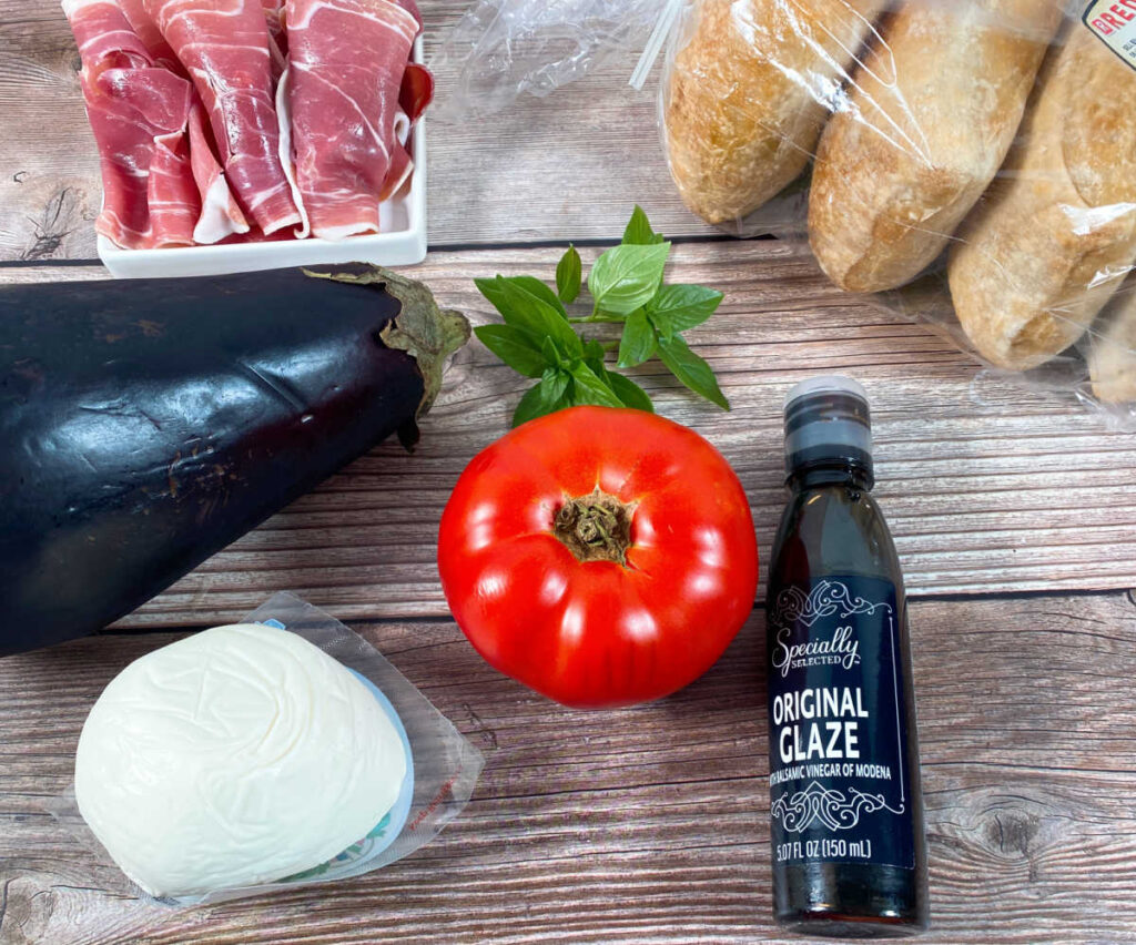 ingredients for the panini sit on a wooden background