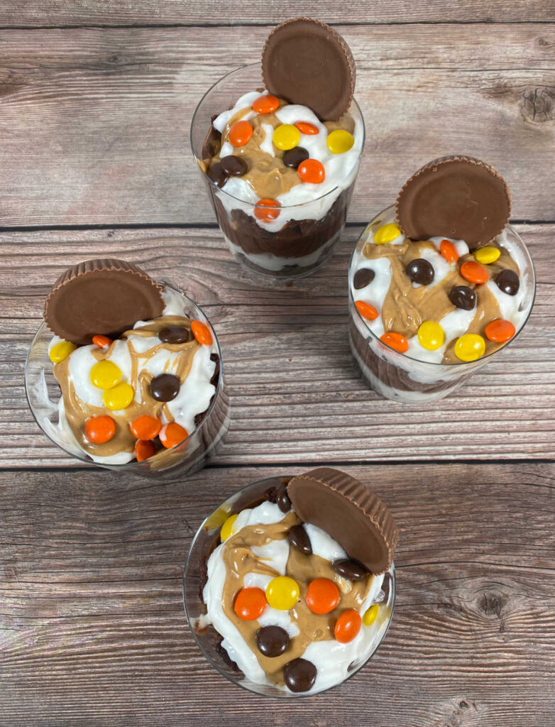 overhead image of the trifles, showing the whipped cream, peanut butter drizzle and peanut butter candies.