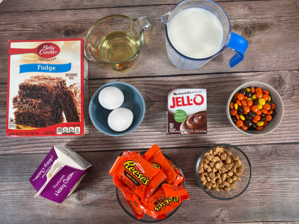 ingredients for the trifles sit in glass bowls on a wooden background.