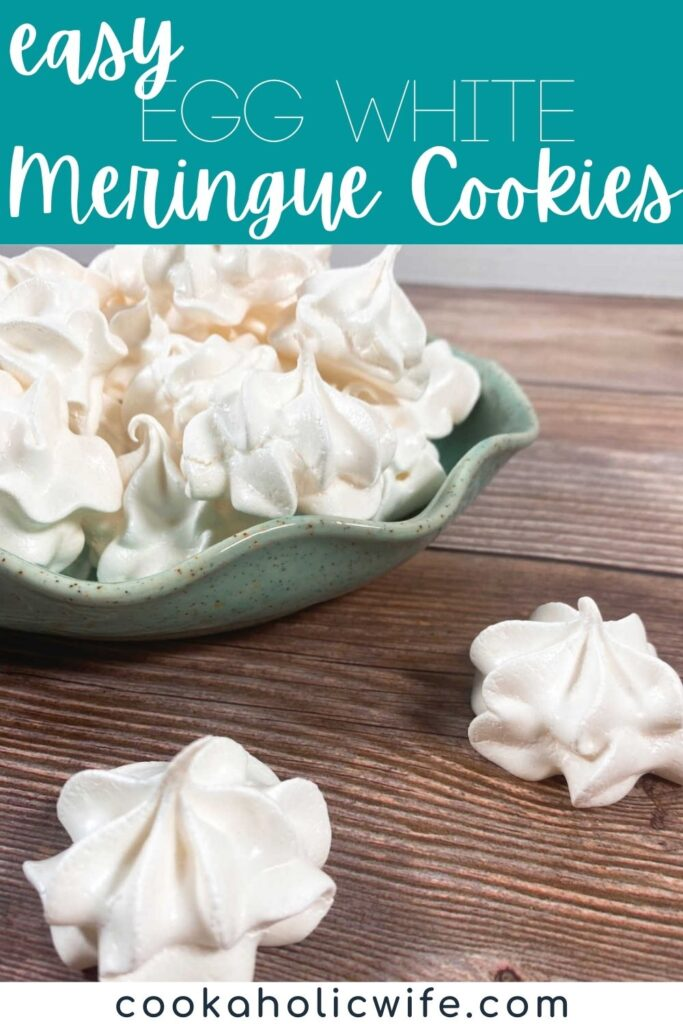Image for Pinterest, text overlay with recipe title at top. green bowl stacked high with meringue cookies sits on a wooden background. two cookies are in front of the bowl on the background.