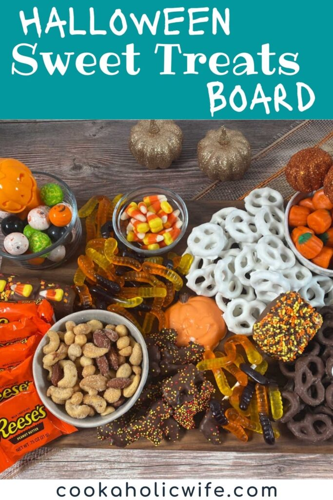image for pinterest with text overlay of recipe title. Chocolate covered pretzels, candy corn, gummy worms and other halloween candy sit on a wooden board.