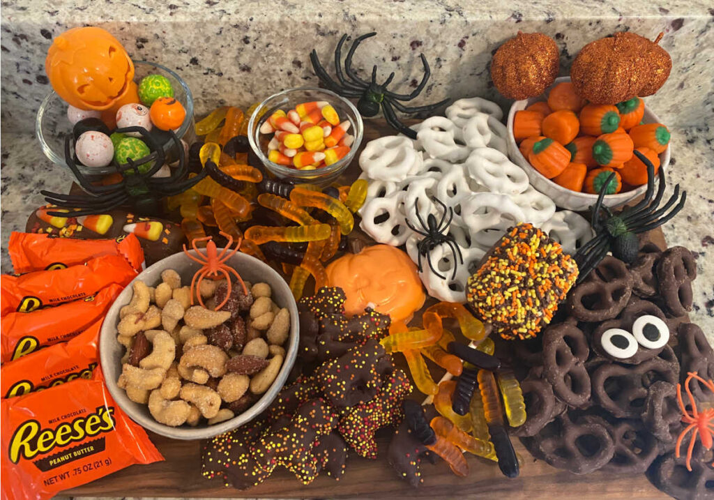 overhead view of the treat board filled with halloween candy and snacks.
