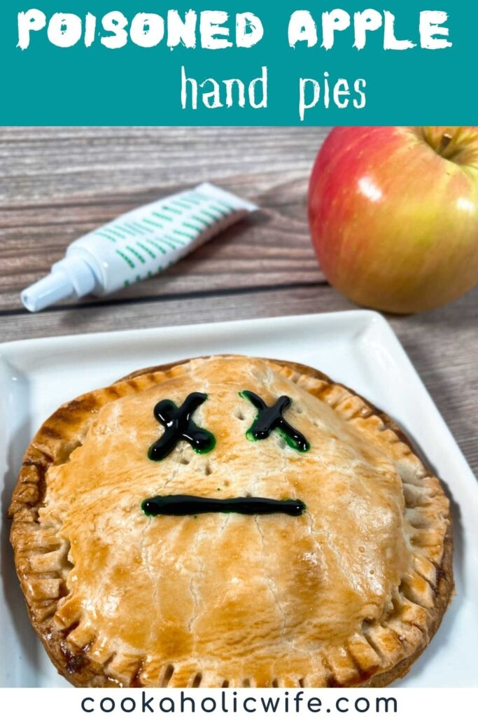 Image for Pinterest with recipe title text overlay. Hand Pie decorated with a Mr. Yuk face sits on a white plate with an apple and food coloring in the background.